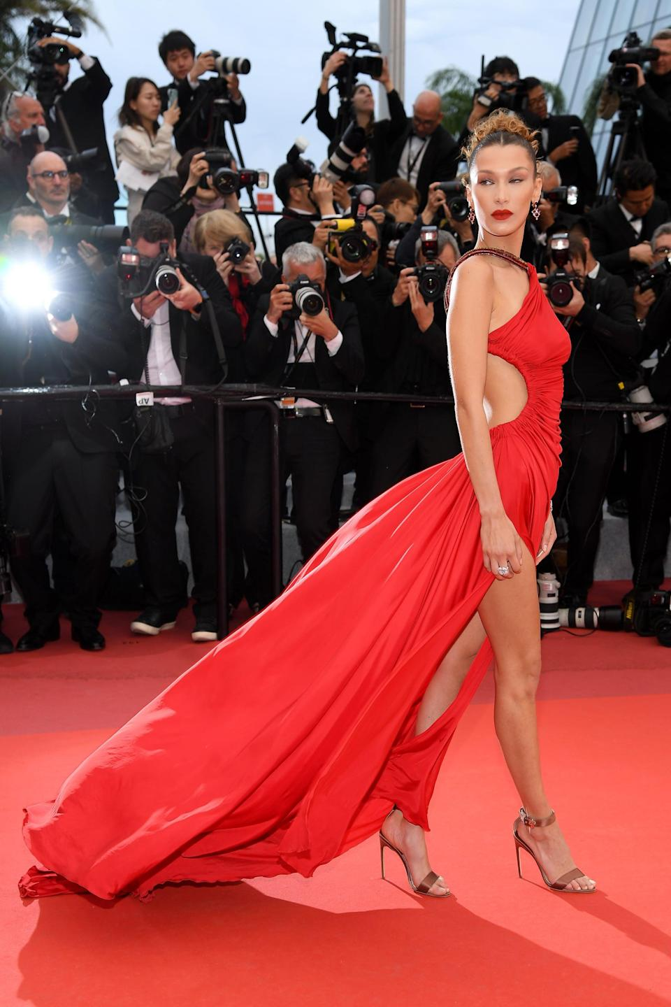 Bella Hadid Wearing a Red Cutout Roberto Cavalli Dress at Cannes in 2019