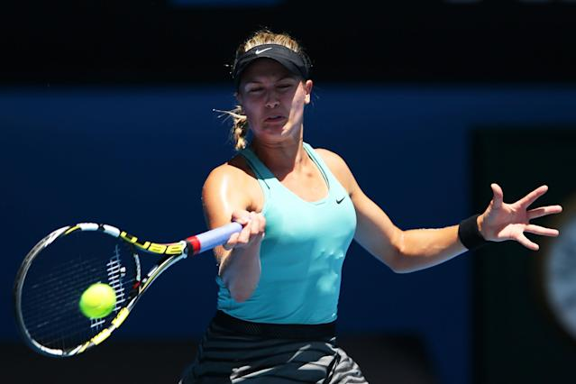 MELBOURNE, AUSTRALIA - JANUARY 21: Eugenie Bouchard of Canada plays a backhand in her quarterfinal match against Ana Ivanovic of Serbia during day nine of the 2014 Australian Open at Melbourne Park on January 21, 2014 in Melbourne, Australia. (Photo by Mark Kolbe/Getty Images)