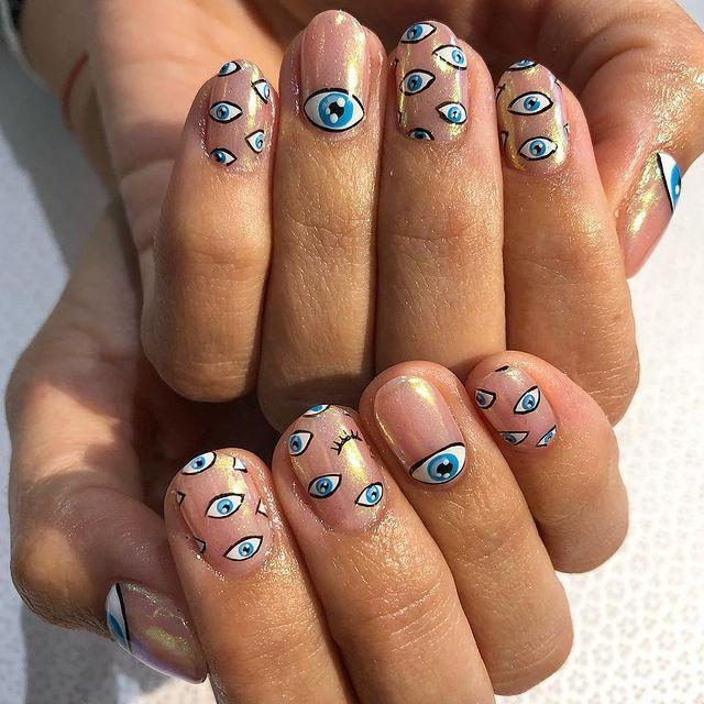 """<p>By laying a holographic pearlescent colour over a neutral pink you can achieve your own variation of rose gold and let your own nail art designs do the talking.</p><p><a href=""""https://www.instagram.com/p/Bk5H3WvHWgI/"""" rel=""""nofollow noopener"""" target=""""_blank"""" data-ylk=""""slk:See the original post on Instagram"""" class=""""link rapid-noclick-resp"""">See the original post on Instagram</a></p>"""