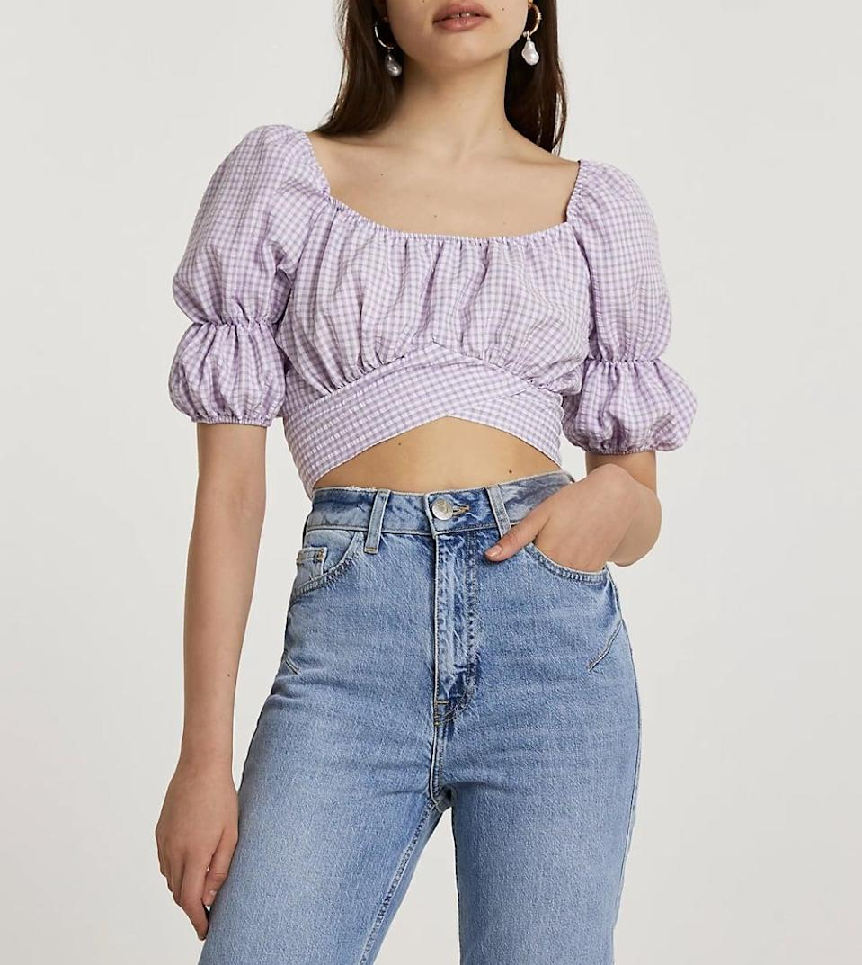 <p>I'm all about the cottagecore vibe of this <span>River Island Purple Puff-Sleeve Gingham Crop Top</span> ($52) - wear it with denim cutoffs and you're good to go.</p>