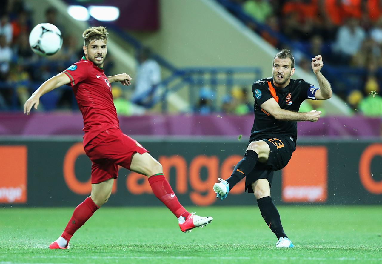 KHARKOV, UKRAINE - JUNE 17:  Rafael van der Vaart (R) of Netherlands scores the opening goal past Miguel Veloso of Portugal during the UEFA EURO 2012 group B match between Portugal and Netherlands at Metalist Stadium on June 17, 2012 in Kharkov, Ukraine.  (Photo by Ian Walton/Getty Images)