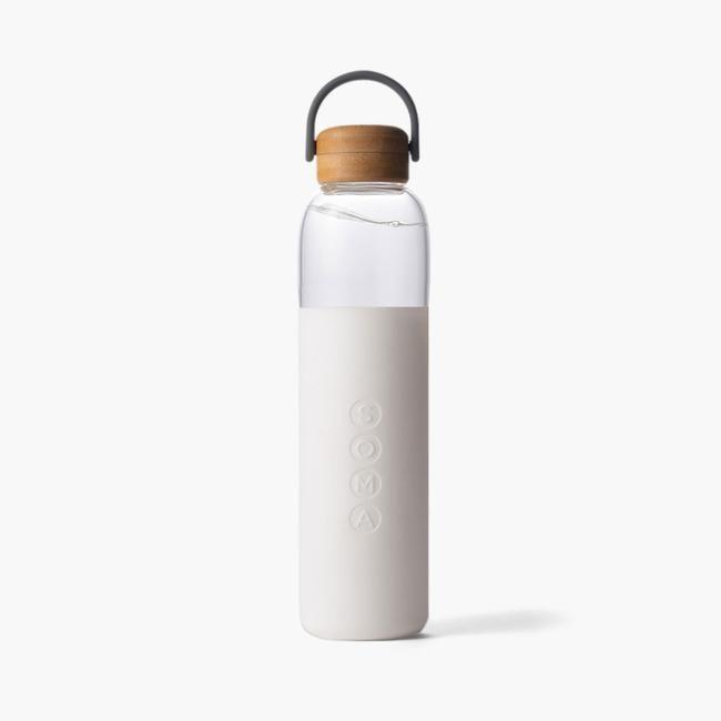"""<p><strong>Soma</strong></p><p>drinksoma.com</p><p><strong>$35.00</strong></p><p><a href=""""https://drinksoma.com/products/25-oz-glass-water-bottle?variant=21177336463419¤cy=USD&gclid=Cj0KCQjw6NmHBhD2ARIsAI3hrM2h7kRemNd3StBqjetTvbAYoZt9R-cqAed9Rj9esL0wangz1hZXEjAaAl0dEALw_wcB"""" rel=""""nofollow noopener"""" target=""""_blank"""" data-ylk=""""slk:Shop Now"""" class=""""link rapid-noclick-resp"""">Shop Now</a></p><p>Avoid long airport check-out lines and help the environment by choosing a glass water bottle that makes staying hydrated a stylish affair. </p>"""