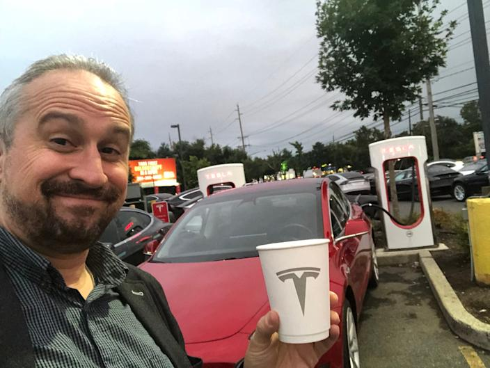 Our tester Tesla Model 3 recharges at a Supercharger station.