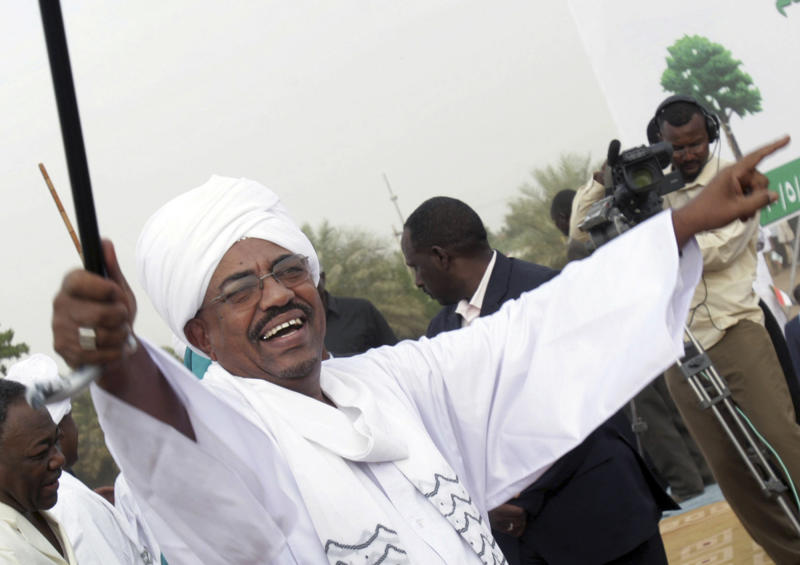 File -- In this Saturday May 1, 2010 file photo, Sudanese President Omar el-Bashir greets his supporters during a rally at a fair in Khartoum, Sudan. Sudan is calling on the United States to issue its president a visa as soon as possible to attend the U.N. General Assembly which opened yesterday, Monday, Sept. 17, 2013. The U.S. State Department said Washington has received Sudan's visa request, but that before presenting himself to the U.N. headquarters, El-Bashir should present himself to the International Criminal Court to answer for crimes linked to the conflict in Darfur. (AP Photo/Abd Raouf, File)