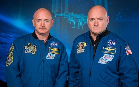 """Nasa astronauts Scott Kelly and his identical twin brother Mark have shared a lot throughout their extraordinary lives. Born just a few minutes apart, the pair were both US Navy captains, both flew on the Endeavour and Discovery space shuttles, and both spent time on board the International Space Station (ISS). But new findings by Nasa have found that life away from planet Earth has exacted a surprising toll. The pair are no longer genetically identical twins. Astronauts Mark, left and Scott Kelly embarked on a groundbreaking experiment looking at genetic impact of spaceflight Credit: Robert Markowitz - Nasa After Scott Kelly, 54, spent 340 days on board the ISS, experts found that seven per cent of his genes no longer match those of brother Mark. Scott may even now be biologically older than his twin, scientists fear. On learning of the change, Scott said: """"What? My DNA changed by 7 per cent. Who knew?! I no longer have to call Mark my identical twin brother anymore."""" Scott Kelly may even be biologically older than his twin brother now Credit: AFP Alexander Nemenov It is well known that astronauts' bodies change to adapt to living in micro-gravity, but it was generally assumed the effects wore off on returning to Earth. However Scott landed in March 2016, and his body has yet to return to normal. Some of the genes which appear to have changed permanently involved DNA repair, bone formation and how the cells use oxygen. Nasa took the unique opportunity of having astronaut twins to learn more about the genetic changes of long periods in space, the first time such a study has ever been attempted. The human body is evolved to live in Earth's gravity, and the long term effects of space habitation are unknown. The space agency said the experiment was a 'stepping stone' in its three-year mission to Mars. Scott Kelly gives himself a flu shot for a study on the human immune system Credit: Nasa While Scott was on the ISS, experts were monitoring Mark's DNA as well as Scott's"""