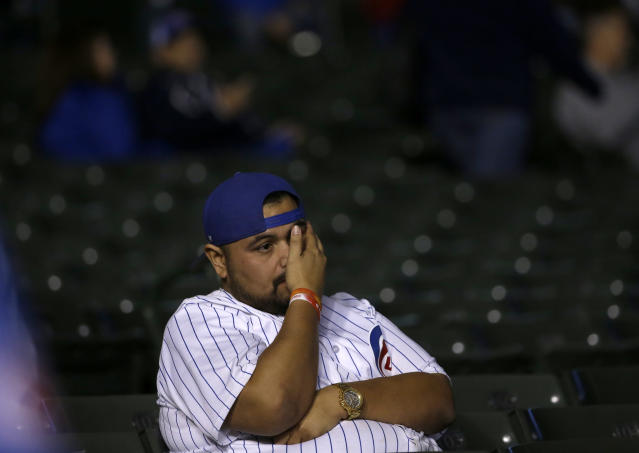 Chicago Cubs fan reacts after Game 3 of baseball's National League Championship Series against the Los Angeles Dodgers, Tuesday, Oct. 17, 2017, in Chicago. The Dodgers won 6-1. (AP Photo/Nam Y. Huh)