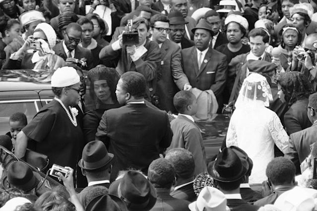 <p>Coretta Scott King arrives at Ebenezer Baptist Church for the funeral of her husband. To her right is the Rev. A. D. King, Dr. King's brother. (Photo: AP) </p>