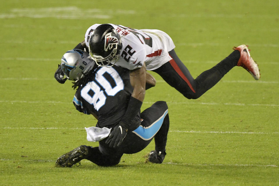 Ian Thomas of the Carolina Panthers is hit by Keanu Neal of the Atlanta Falcons. (Photo by Grant Halverson/Getty Images)