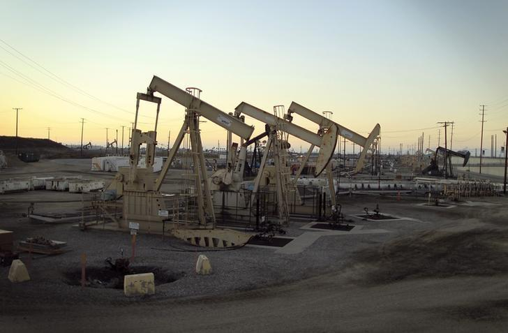 Oil rig pumpjacks extract crude from the Wilmington Field oil deposits area where Tidelands Oil Production Company, which is owned by Occidental Petroleum Corporation, operates near Long Beach, California