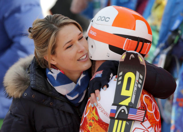 United States' Bode Miller and his wife, Morgan, embrace after his run in the men's super-G at the Sochi 2014 Winter Olympics, Sunday, Feb. 16, 2014, in Krasnaya Polyana, Russia. (AP Photo/Christophe Ena)
