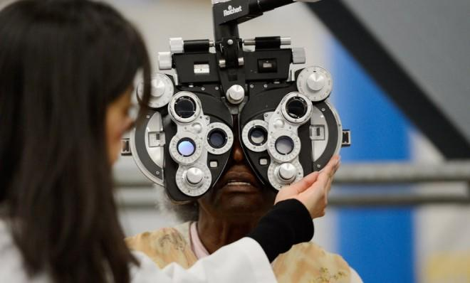 An eye examination is performed as part of a free health care service at the Care Harbor clinic at the Los Angeles Sports Arena in September 2012.