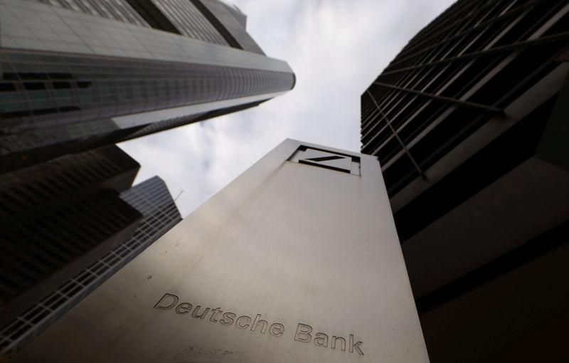 FILE PHOTO: The logo of Deutsche Bank is seen in front of one of the bank's office buildings in Frankfurt