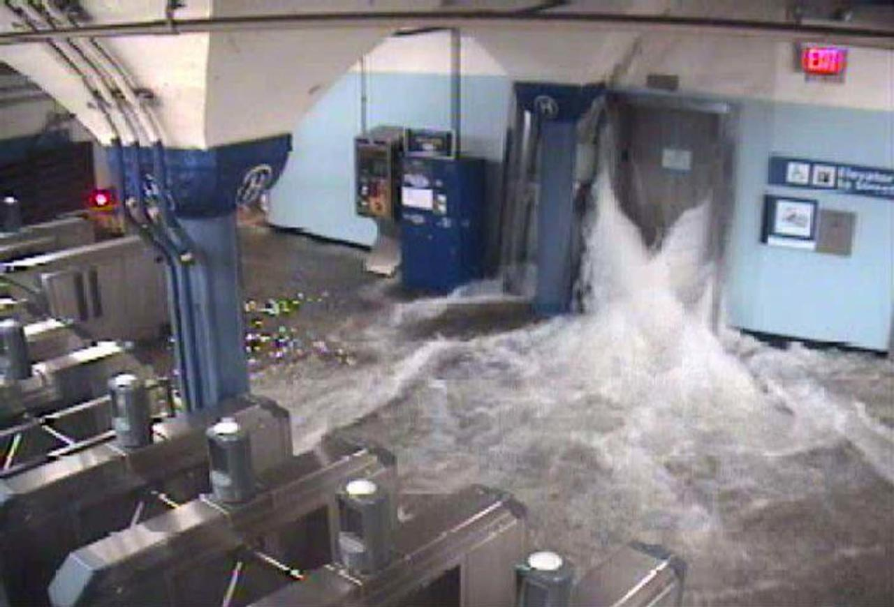 Floodwaters from Hurricane Sandy rush into the Port Authority Trans-Hudson's (PATH) Hoboken, New Jersey station through an elevator shaft in this video frame grab from the NY/NJ Port Authority twitter feed October 29, 2012.  REUTERS/NY/NJ Port Authority/Twitter