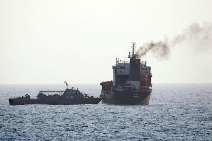 A handout image released by the US Central Command on August 13, 2020 reportedly shows Iranian forces boarding a tanker in international waters in the Gulf of Oman, one of a series of incidents in the tense waters