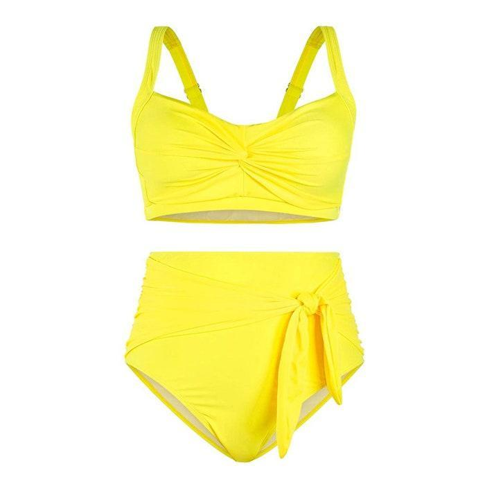 """It's time you added a vibrant, yellow swimsuit to your roster. $30, Amazon. <a href=""""https://www.amazon.com/Sovoyontee-Womens-Waisted-Swimsuit-Bathing/dp/B08QYYXZM5/"""" rel=""""nofollow noopener"""" target=""""_blank"""" data-ylk=""""slk:Get it now!"""" class=""""link rapid-noclick-resp"""">Get it now!</a>"""
