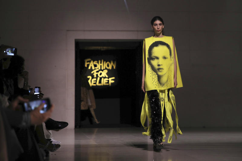 A model, wearing an outfit which has on it the image of model Kate Moss, walks the runway at the Fashion For Relief charity event in central London, Saturday, Sept. 14, 2019. (Photo by Vianney Le Caer/Invision/AP)