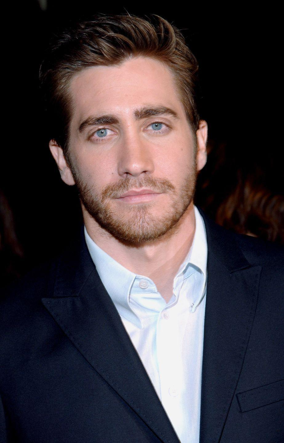 <p>Jake Gyllenhaal has become known for his consistent scruff and short swept hair ever since the actor was starting out in movies like <em>Donnie Darko</em>. </p>