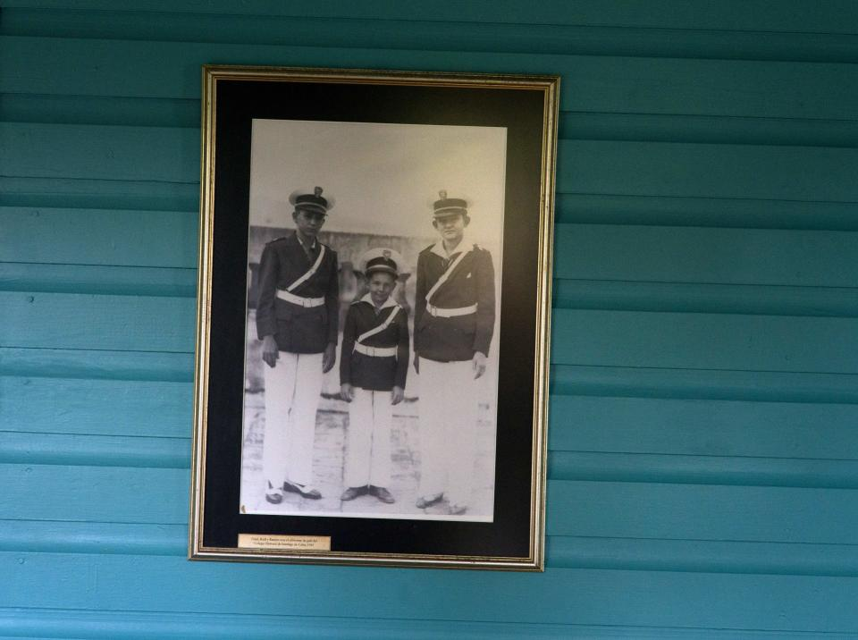 FILE - This June 10, 2016 file photo shows a family photograph of the Castro brothers, from left, Fidel, Raul and Ramon, on the wall of the room they shared as children in Biran, Cuba. For most of his life, Raul Castro played second-string to his brother, but for the past decade, it's Raul who's been the face of communist Cuba. On Friday, April 16, 2021, Raul Castro formally announced he'd step down as head of the Communist Party, leaving Cuba without a Castro in an official position of command for the first time in more than six decades. (AP Photo/Ramon Espinosa, File)