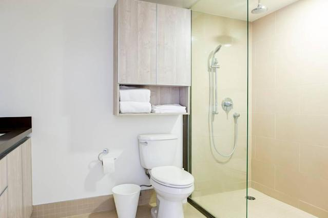 <p>There are also three bathrooms, including this master suite with walk-in shower. (Airbnb) </p>