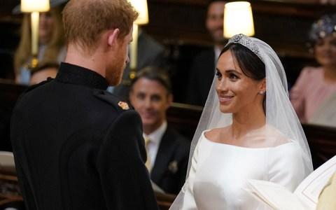 Prince Harry and Meghan Markle during their wedding at St George's Chapel - Credit:  Dominic Lipinski/PA