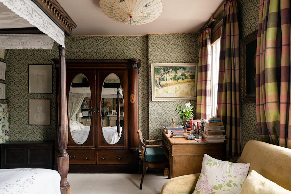 Character development: the walls of each room are filled with an eclectic mixture of art and patterned wallpaperInigo