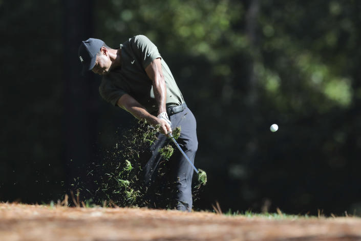 Tiger Woods tees off on the 11th hole during the first round of the Masters golf tournament Thursday, Nov. 12, 2020, in Augusta, Ga. (Curtis Compton/Atlanta Journal-Constitution via AP)