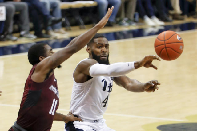 Pittsburgh's Jared Wilson-Frame (4) passes as Maryland Eastern Shore's Ahmad Frost (11) defends during the first half of an NCAA college basketball game, Saturday, Dec. 15, 2018, in Pittsburgh. (AP Photo/Keith Srakocic)
