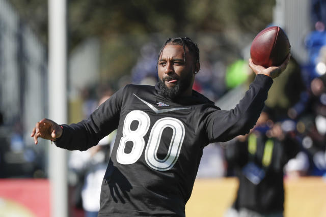 AFC wide receiver Jarvis Landry of the Cleveland Browns tosses the ball back after making a reception during a practice for the NFL Pro Bowl football game Wednesday, Jan. 22, 2020, in Kissimmee, Fla. (AP Photo/John Raoux)