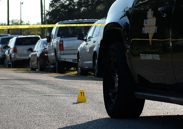 <p>An evidence marker sits on the road in front of a Texas Department of Public Safety vehicle outside the First Baptist Church in Sutherland Springs, Texas, Nov. 5, 2017. (Photo: R. Tomas Gonzalez/EPA-EFE/REX/Shutterstock) </p>