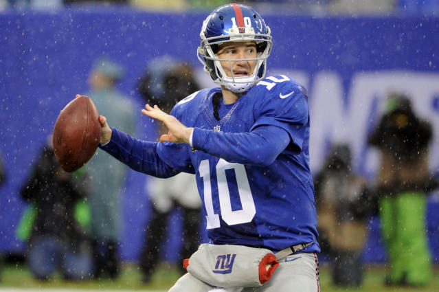 New York Giants quarterback Eli Manning throws a pass during the first half of an NFL football game against the Washington Redskins Sunday, Dec. 29, 2013, in East Rutherford, N.J. (AP Photo/Bill Kostroun)