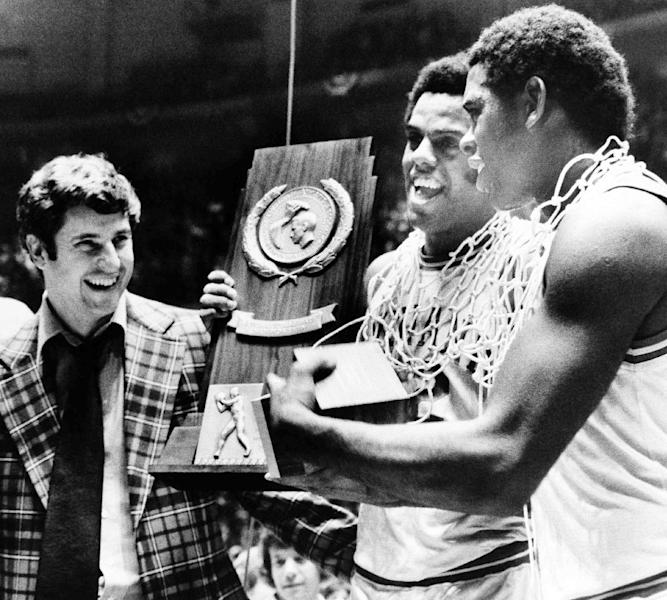 FILE - In this March 29, 1976, file photo, Indiana coach Bobby Knight, left, forward Scott May, center, and guard Quinn Buckner hold the trophy after defeating Michigan 86-68 to win the NCAA college basketball tournament championship in Philadelphia. Knight is selling his championship basketball rings and Olympic gold medal. A collection of the former coach's memorabilia will be auctioned through Dec. 5, 2012, by Steiner Sports Memorabilia. (AP Photo, File)