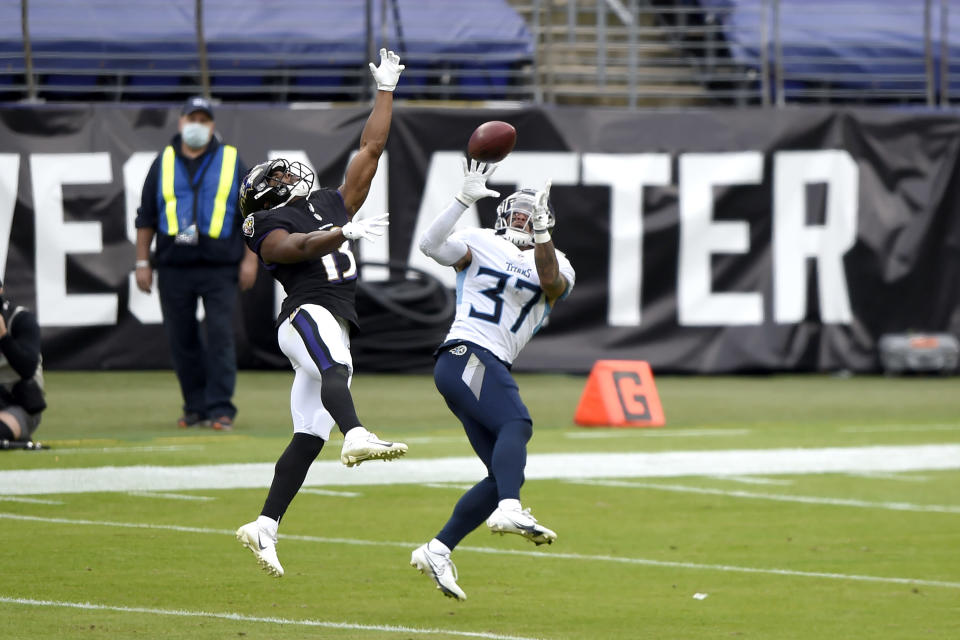 Tennessee Titans safety Amani Hooker (37) prepares to intercept a pass from Baltimore Ravens quarterback Lamar Jackson, not visible, intended for wide receiver Devin Duvernay (13) during the second half of an NFL football game, Sunday, Nov. 22, 2020, in Baltimore. (AP Photo/Gail Burton)