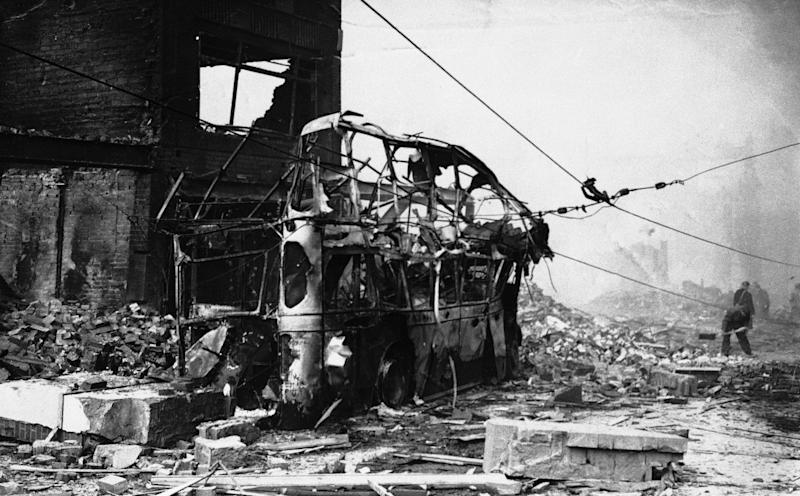 The remains of a bomb wrecked trolley bus, a victim of the Luftwaffe's large scale dive bombing attack in Coventry, England on Nov. 14, 1940. (AP Photo)