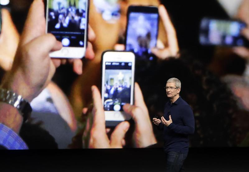 FILE - In this Wednesday, Sept. 7, 2016, file photo, Apple CEO Tim Cook announces the new iPhone 7 during an event to announce new products, in San Francisco. Apple still hasn't shown any sign of being able to duplicate its late founder Steve Jobs' knack for game-changing innovation, but that isn't stopping the world's most valuable company from reaching new heights. The main reason: Before Jobs died in 2011, he left behind the iPhone, a product with such a devout following that it's expected to generate billions of dollars in profit for the foreseeable future even if the company isn't as clever as it once was. (AP Photo/Marcio Jose Sanchez, File)