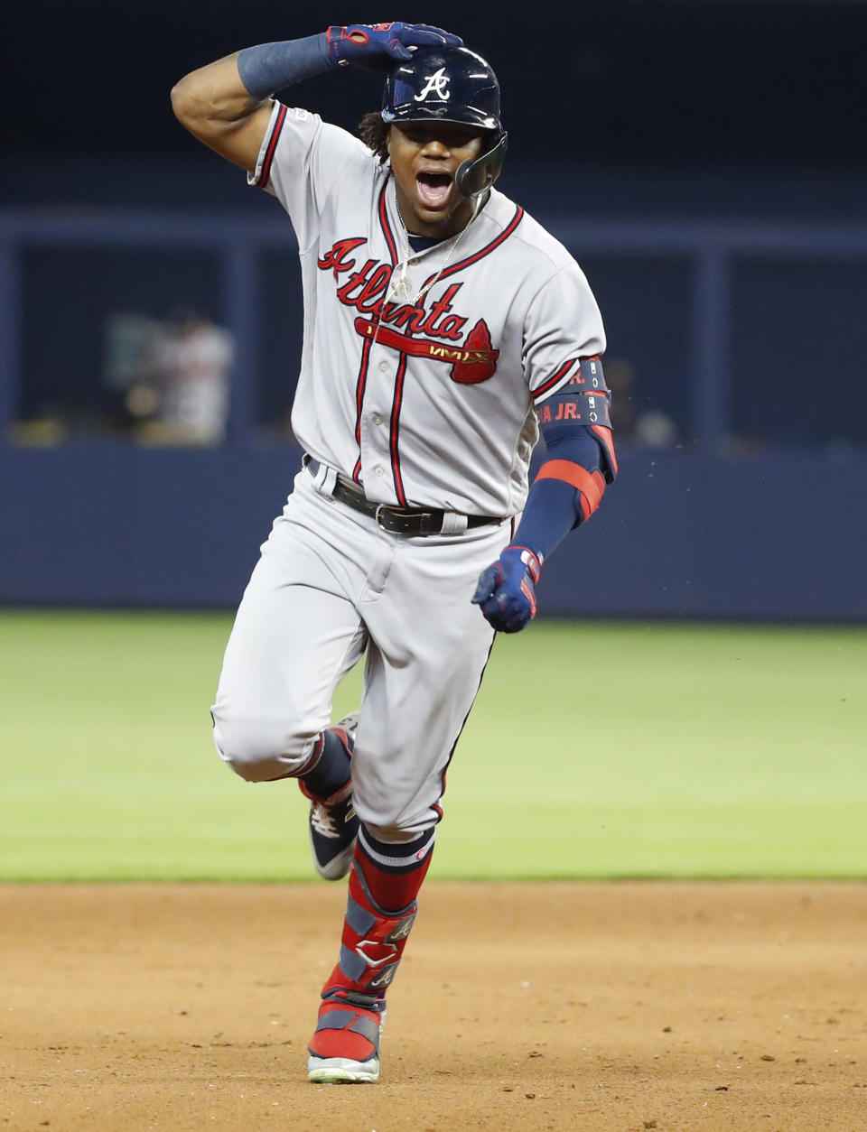 Atlanta Braves' Ronald Acuna Jr. celebrates as he rounds second base after he hit a three-run home run scoring Matt Joyce and Johan Camargo during the ninth inning of a baseball game against the Miami Marlins, Sunday, June 9, 2019, in Miami. The Braves defeated the Marlins 7-6 in 12 innings. (AP Photo/Wilfredo Lee)