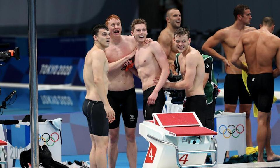 Tames Guy, Tom Dean, Duncan Scott and Matthew Richards of Team Great Britain celebrate their victory.