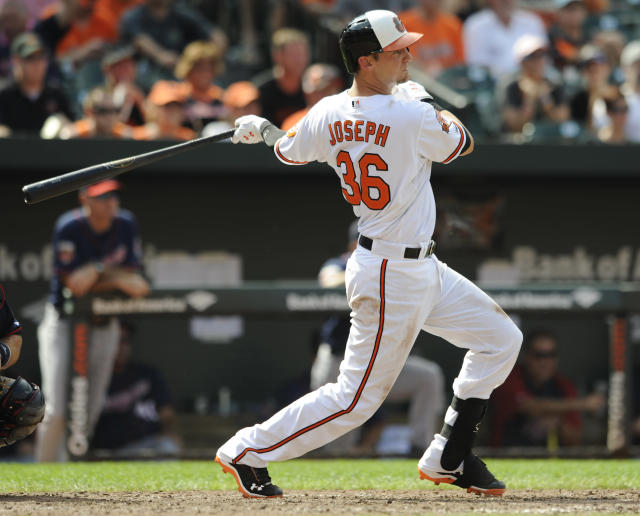 Baltimore Orioles' Caleb Joseph singles against the Minnesota Twins in sixth the inning of a baseball game, Sunday, Aug. 31, 2014, in Baltimore. The Orioles won 12-8. (AP Photo/Gail Burton)
