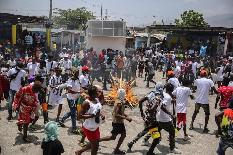 Haitians march to demand justice for slain President Jovenel Moïse in Lower Delmas, a district of Port-au-Prince, Haiti, on Monday, July 26, 2021. Moïse was assassinated on July 7 at his home.