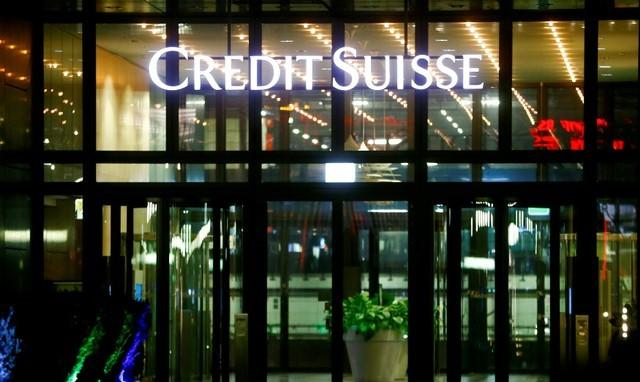 FILE PHOTO: The logo of of Swiss bank Credit Suisse is seen at an office building in Zurich's Oerlikon suburb