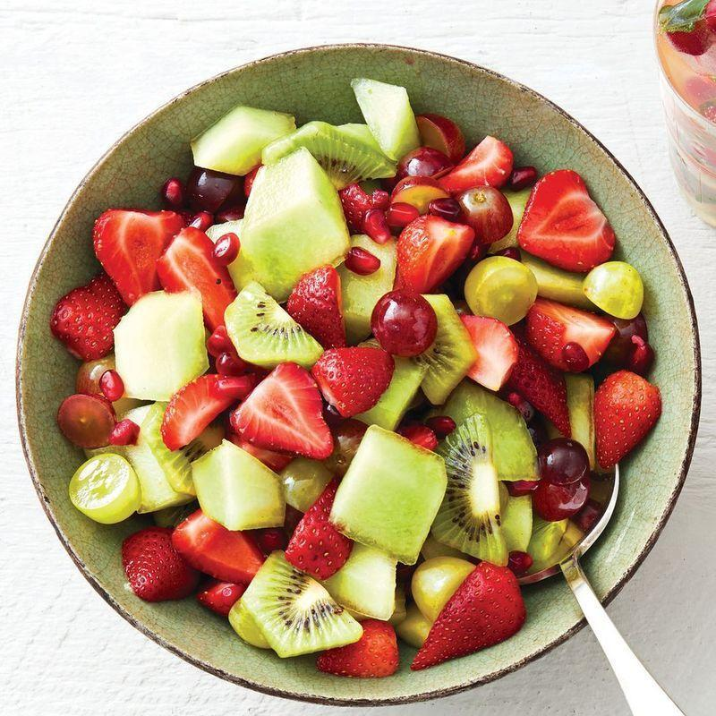 """<p>A minty syrup helps to liven up this simple fruit salad. Don't be surprised if your guests ask you for the recipe after the meal.</p><p><strong><a href=""""https://www.thepioneerwoman.com/food-cooking/recipes/a34658505/red-and-green-fruit-salad-with-mint-syrup-recipe/"""" rel=""""nofollow noopener"""" target=""""_blank"""" data-ylk=""""slk:Get the recipe"""" class=""""link rapid-noclick-resp"""">Get the recipe</a>.</strong></p><p><a class=""""link rapid-noclick-resp"""" href=""""https://go.redirectingat.com?id=74968X1596630&url=https%3A%2F%2Fwww.walmart.com%2Fbrowse%2Fhome%2Fserveware%2Fthe-pioneer-woman%2F4044_623679_639999_2347672&sref=https%3A%2F%2Fwww.thepioneerwoman.com%2Ffood-cooking%2Fmeals-menus%2Fg32157273%2Ffourth-of-july-appetizers%2F"""" rel=""""nofollow noopener"""" target=""""_blank"""" data-ylk=""""slk:SHOP SERVING BOWLS"""">SHOP SERVING BOWLS</a></p>"""