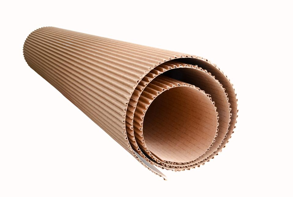 corrugated cardboard rolled up, isolated on white background