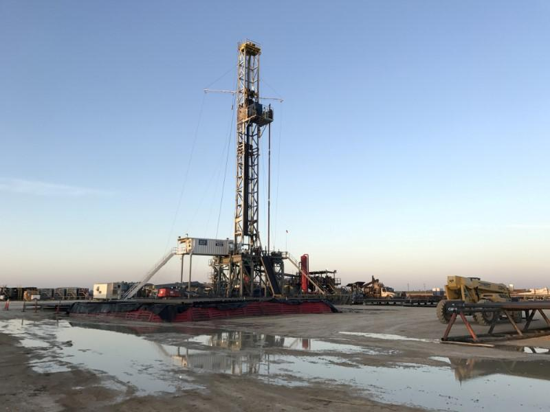 FILE PHOTO - A drilling rig owned by Parsley Energy Inc. near Midland