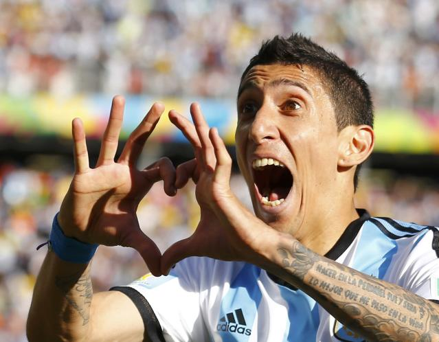 Argentina's Angel Di Maria celebrates scoring against Switzerland during extra time in their 2014 World Cup round of 16 game at the Corinthians arena in Sao Paulo July 1, 2014. REUTERS/Ivan Alvarado (BRAZIL - Tags: SOCCER SPORT WORLD CUP TPX IMAGES OF THE DAY) TOPCUP