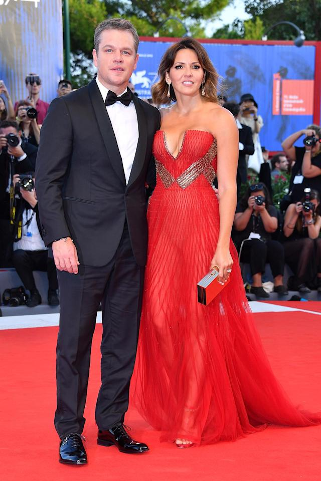 Matt Damon and Luciana Barroso walk the red carpet in Venice, Italy. (Photo: Getty Images)