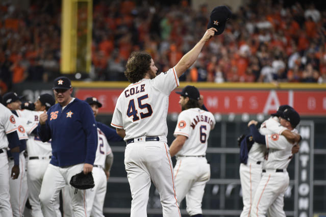 Houston Astros starting pitcher Gerrit Cole (45) celebrates with teammates after their win over the Tampa Bay Rays in Game 5 of a baseball American League Division Series in Houston, Thursday, Oct. 10, 2019. (AP Photo/Eric Christian Smith)