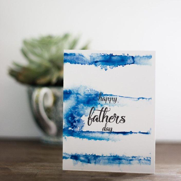 """<p>This watercolor Father's Day card basically doubles as a work of art. </p><p><strong><em>Get the printable at <a href=""""https://www.tinselbox.com/free-printable-cards-for-fathers-day/"""" rel=""""nofollow noopener"""" target=""""_blank"""" data-ylk=""""slk:Tinsel Box"""" class=""""link rapid-noclick-resp"""">Tinsel Box</a>. </em></strong></p>"""