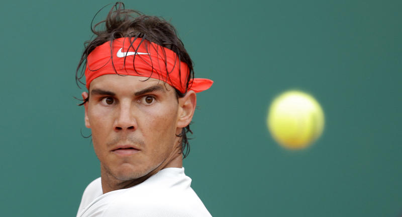 Spain's Rafael Nadal plays a return to Grigor Dimitrov of Bulgaria during their quarter final match of the Monte Carlo Tennis Masters tournament in Monaco, Friday, April 19, 2013. (AP Photo/Lionel Cironneau)