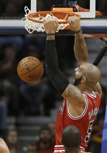 Chicago Bulls' Carlos Boozer dunks against the Cleveland Cavaliers in the first quarter of an NBA basketball game Friday, Nov. 2, 2012, in Cleveland. (AP Photo/Mark Duncan)