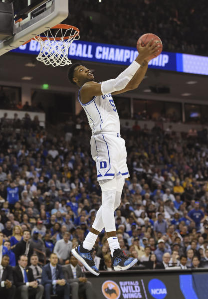 Duke's RJ Barrett (5) goes up for a dunk against North Dakota State in a first-round game in the NCAA men's college basketball tournament in Columbia, S.C. Friday, March 22, 2019. (AP Photo/Richard Shiro)