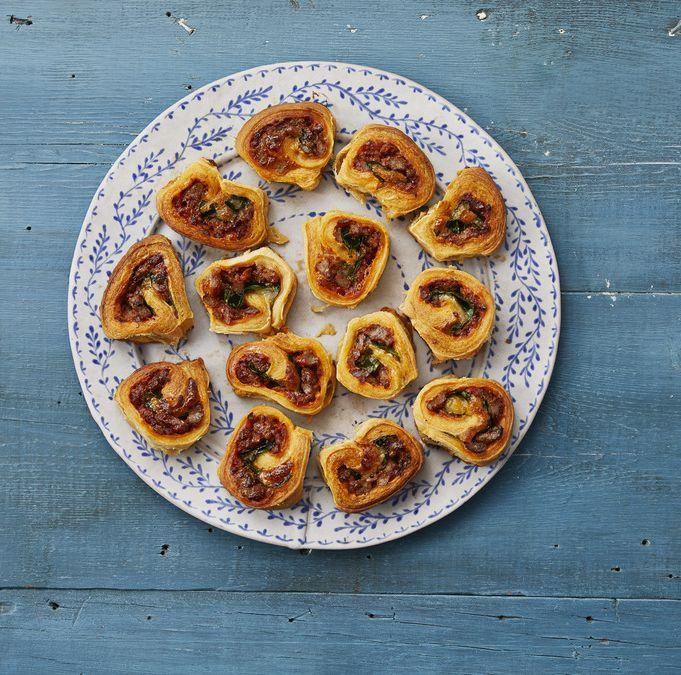 """<p>Refrigerated crescent roll dough is the secret to this surprisingly easy appetizer. The pinwheels are filled with hot Italian sausage, spinach, and cheese. </p><p><a href=""""https://www.thepioneerwoman.com/food-cooking/recipes/a34691212/eddie-jackson-sausage-pinwheels-recipe/"""" rel=""""nofollow noopener"""" target=""""_blank"""" data-ylk=""""slk:Get Ree's recipe."""" class=""""link rapid-noclick-resp""""><strong>Get Ree's recipe.</strong></a></p>"""